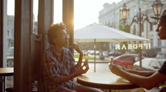Beautiful friends eating speaking resting sitting in cafe Slow motion Stock Footage