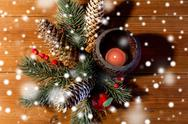 Christmas fir branch decoration and candle lantern Stock Photos