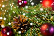 Fir branch with christmas ball and pinecones Stock Photos