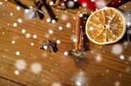Cinnamon, anise and dried orange on wooden board Stock Photos