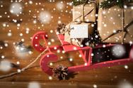 Close up of christmas gifts with note on sleigh Stock Photos