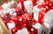 Close up of gift boxes on wooden floor Stock Photos