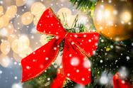 Close up of red bow decoration on christmas tree Stock Photos