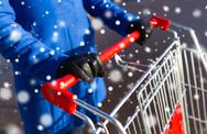 Close up of woman with shopping cart on street Stock Photos