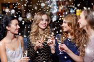 Happy women with champagne glasses at night club Stock Photos