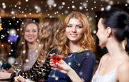 Happy women with drinks at night club over snow Stock Photos