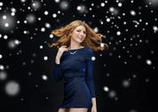 Happy young woman dancing over snow Stock Photos