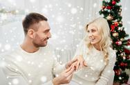 Man giving engagement ring to woman for christmas Stock Photos