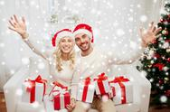Happy couple at home with christmas gift boxes Stock Photos