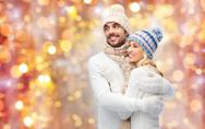 Smiling couple in winter clothes hugging Stock Photos