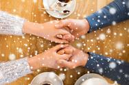 Close up of couple holding hands at restaurant Stock Photos
