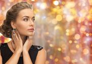 Beautiful woman with gem stone earrings Stock Photos