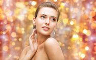 Beautiful woman with diamond earrings Stock Photos
