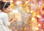 Smiling little girl with gift box Stock Photos