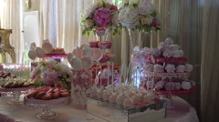 Candy Bar on a Table With Flowers at a Wedding Stock Footage