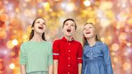 Amazed children looking up over holidays lights Stock Photos