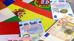 Eurozone country flags alongside euro notes and coins. Stock Footage