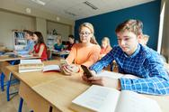 Students with smartphone texting at school Stock Photos