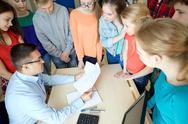 Group of students and teacher with tests at school Stock Photos