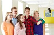 Students taking selfie with smartphone at school Stock Photos