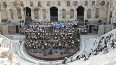 Musicians at the odeon of herodes atticus in athens, greece Stock Footage