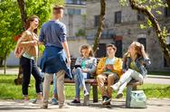 Teenage students with tablet pc at school yard Stock Photos