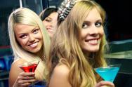 Three girls with martini glasses looking at camera and smiling Stock Photos