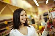 Beautiful girl at supermarket Stock Photos
