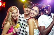 four friends at club looking at camera and smiling Stock Photos