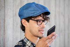 Man recording voice or calling on smartphone Stock Photos