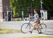 Young man with fixed gear bicycle on crosswalk Stock Photos