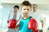 Little serious boys in boxing gloves looking at camera Stock Photos