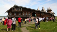 Tourists on the territory Kizhi pogost on Kizhi Island in Russia Stock Footage