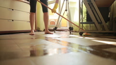 Woman makes cleaning. girl cleaning the floor mop. cleaning Stock Footage