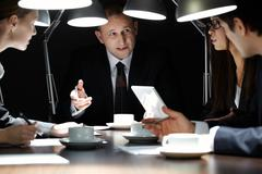 Chief manager holding meeting late in the evening Stock Photos