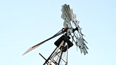 Close up of a farm windmill against skies. 4K Stock Footage