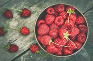 Raspberries in wooden bowl Stock Photos