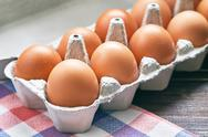 Chicken eggs in pulp egg carton Stock Photos