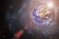 Earth and galaxy. Elements of this image furnished by NASA. Stock Photos