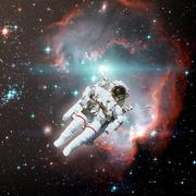 Astronaut in outer space. Nebula on the background. Kuvituskuvat