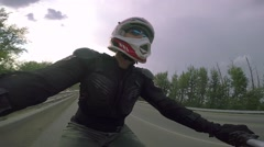 A man rides a quad bike on the road Stock Footage
