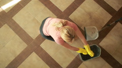 Woman cleaning the floor. girl in gloves cleans the kitchen Stock Footage