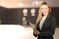 The Beautiful smiling business woman portrait. Smiling female receptionist Kuvituskuvat