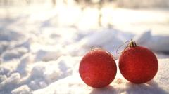 Christmas balls on snow drift slowmotion Stock Footage