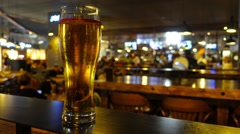 Full glass of beer in the bar Stock Footage