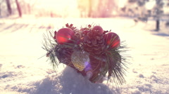 Christmas decoration on snow drift slowmotion Stock Footage