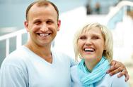 Laughing couple looking at camera Stock Photos