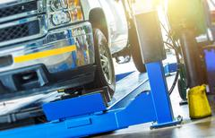 Car Wheel Alignment Check. Large Pickup Truck on the Alignment Equipment Stock Photos