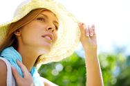 A woman sitting in summer hat Stock Photos