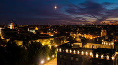 Night in Vilinus, Lithuania. Time-lapse of moon and clouds Stock Footage